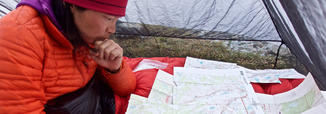 Szu-ting Yi looking over maps in the Winds